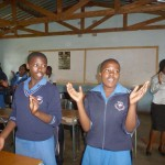 Members of the Mhlanghya Girls Empowerment Club singing the club song, The Sky is the Limit.
