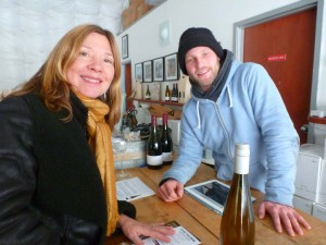 Discussing pinot noirs with a winemaker at Norman Hardie Winery.