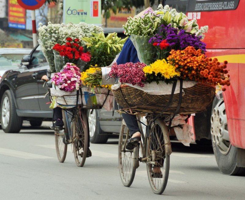 Ladies load up their bikes with the most beautiful bouquets of fresh flowers.