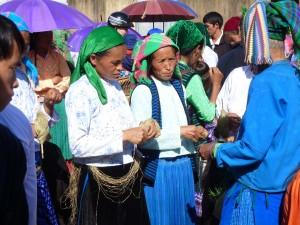 Ladies selling homespun yarn at the market.