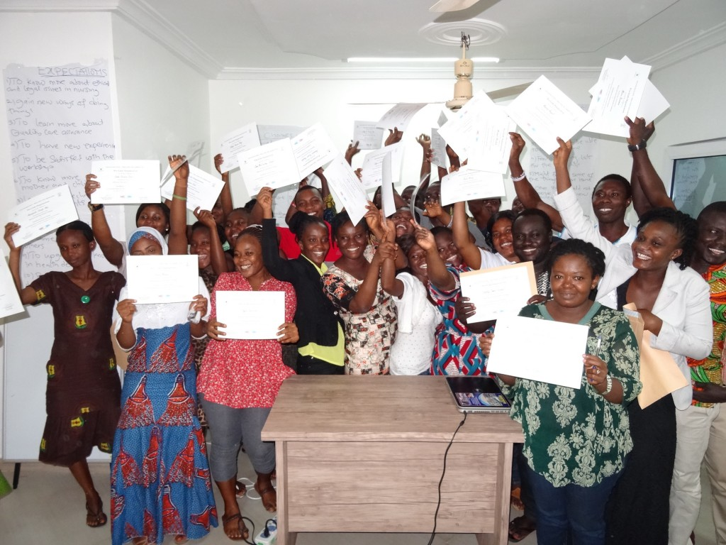 Nurses with their training certificates.